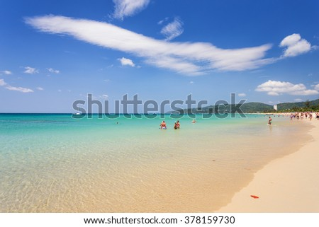 Phuket-Karon beach-February 16,2016: Some unidentified people are relaxing on Karon beach during sunny day in Phuket, Thailand