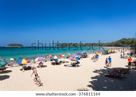 Phuket-Kata beach-January 13, 2016: Some unidentified people are relaxing on Kata beach during a sunny day in Phuket, Thailand. Kata is a famous Phuket beach