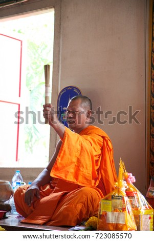 PHUKET - NOVEMBER 16: Thai monks at Wat Chalong temple in Phuket give blessings and receive offerings on November 16, 2005 in Phuket, Thailand.