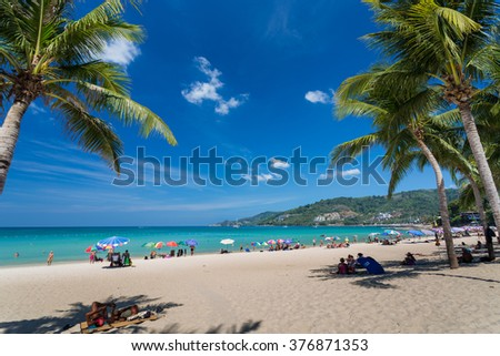 Phuket-Patong beach-February 27,2015: People relax on Patong beach during sunny day in Phuket, Thailand.Patong is one of famous beach located in the west coast of Phuket island