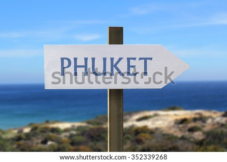 Phuket sign with seaside in the background