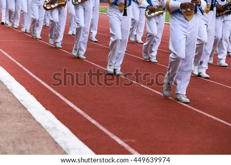 Phuket, Thailand - December 17, 2014 : An unidentified Feet of March Band marching at the parade in orange floor at Phuket