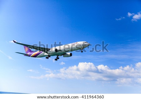 PHUKET, THAILAND - December 2015 : Thai airways airplane Landing at Phuket International airport in sunny day on December 25, 2015 in Phuket, Thailand.