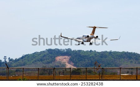 Phuket,Thailand - December 29, 2014: the beach landscape, the plane comes in the land
