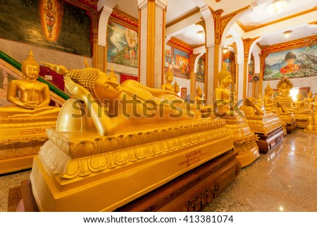 PHUKET, THAILAND - FEB 6: Sleeping Buddha statue and other inside hall of famous Wat Chalong on February 6, 2016. First written mention about the buddhist monastery belongs to 1837 - stock photo