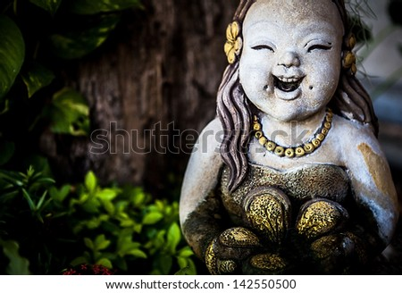 PHUKET, THAILAND - FEB 08: Traditional Asian statues from a stone. Fair of handicraftsmen on Wat Chalong. on 08 February 2013 Phuket, Thailand.