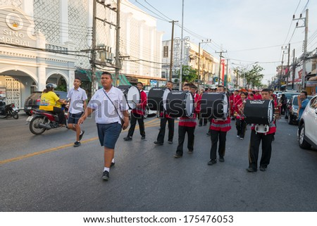 PHUKET, THAILAND - 07 FEB 2014: unidentified participant(s) in procession parade of annual old Phuket town festival.