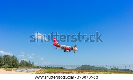 Phuket,Thailand - February 16, 2016 : Airasia landing at Phuket international airport on February 16, 2016. The plane comes in Phuket international airport.