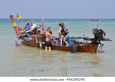 PHUKET,THAILAND - FEBRUARY 26,2011:Tourists sit in a boat on a tour