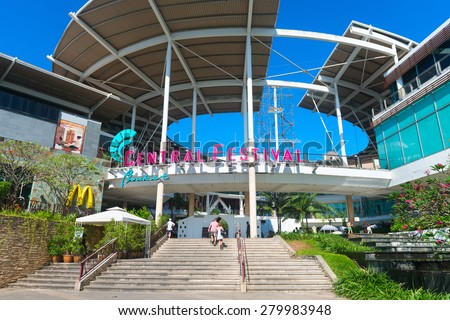 PHUKET, THAILAND - 10 JAN 2015: Main entrance to Central Festival, one of the region's premier shopping malls, with its landscaped gardens and decorative fountains. - stock photo