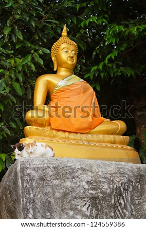 PHUKET, THAILAND - JANUARY 05: Buddha statue in Wat Chalong - the most important of the 29 buddhist temples of Phuket, January 05, 2013 in Phuket, Thailand.