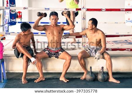 PHUKET , THAILAND - JANUARY 26 , 2016: unidentified kick boxing athletes in unidentified Muay thai boxe and martial arts training camp on January 26 , 2016 in Patong , Phuket , Thailand. - stock photo