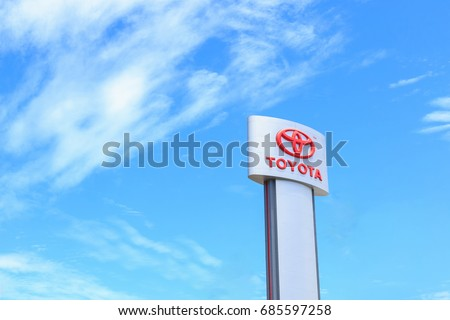 PHUKET, THAILAND - JULY 28, 2017 : TOYOTA logo installed outdoor to indicate the sale and service center. TOYOTA is Japanese's car manufacturer which sold around the world.