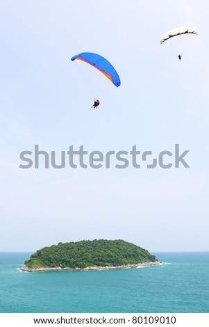 "PHUKET, THAILAND - JUNE 26: An unidentified group of paragliders competes in the annual ""Phuket Fun Fly "" paragliding competition sponsored by Canon on June 26, 2011 in Phuket, Thailand."