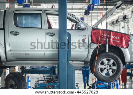 PHUKET, THAILAND - JUNE 30 : Car technician repairing car in workshop service station in Phuket on June 30, 2016. The official dealer of Toyota, who is the top market share for commercial car. - stock photo