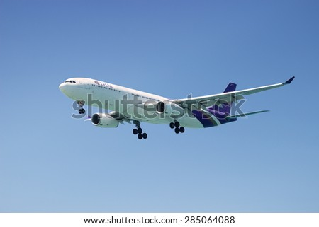 PHUKET, THAILAND - MAR 02 2015: HS-TEO Airbus A330-343X of Thai Airways International. Landing in Phuket International Airport. Thailand - stock photo