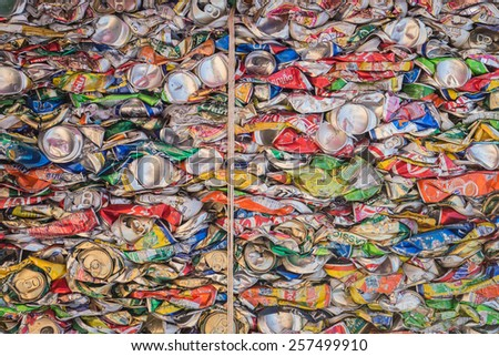 PHUKET, THAILAND - MARCH 3 : Crushed soda and beer cans at a recycling facility in Phuket on March 3, 2015. The cans will be shipped to an aluminum foundry. - stock photo