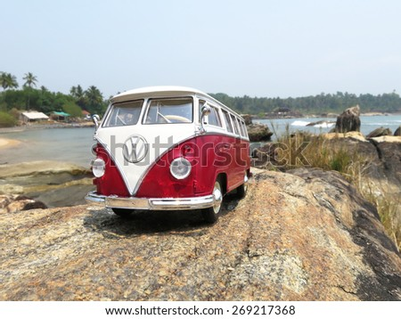 PHUKET, THAILAND - MARCH 27, 2015: Miniature VW Bulli 1962 on the rock. The cult car of the Hippie generation and it remained the status vehicle of the high wave surfers. - stock photo
