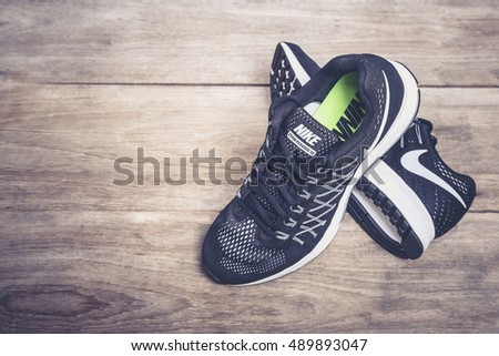 PHUKET, THAILAND - MARCH 6 : New style nike shoes. Taken at studio on wooden plank on March 6, 2016 in Phuket, Thailand. Nike is one of the world's largest suppliers of athletic shoes and apparel.