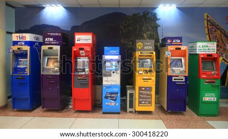 PHUKET, THAILAND - MAY 24, 2015: ATM cash machines by various banks located inside Phuket international airport. ATM is widely available all over Thailand. - stock photo