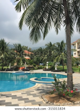 Phuket, Thailand - May 15, 2015: Beautiful swimming pool in Patong luxury resort, Phuket, south of Thailand. Phuket is home to many high-end seaside resorts, spas and restaurants.