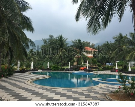 Phuket, Thailand - May 15, 2015: Beautiful swimming pool in tropical resort, Phuket, south of Thailand. Phuket is home to many high-end seaside resorts, spas and restaurants.