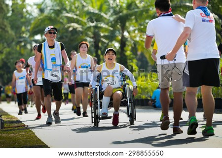 PHUKET, THAILAND - MAY 07: Mika Imai no.21327 on wheelchair in 10.5 km.Run at the Laguna Phuket  International marathon at Laguna on May 07, 2015 in Phuket, Thailand. - stock photo