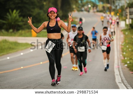 PHUKET, THAILAND - MAY 07: Pattra Kangwankit no.10893 of Thailand run the marathon  during  the Laguna Phuket  International marathon at Laguna on May 07, 2015 in Phuket, Thailand. - stock photo