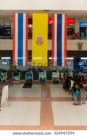 PHUKET, THAILAND - 06 MAY 2014: Registering check-in desks with hanged over big Thai national flag the international departures area at Phuket International Airport. - stock photo