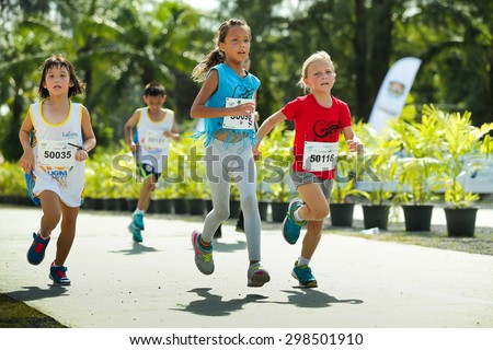 PHUKET, THAILAND - MAY 07: Unidentified children participants compete at  the Laguna Phuket  International marathon at Laguna on May 07, 2015 in Phuket, Thailand. - stock photo