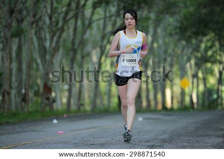 PHUKET, THAILAND - MAY 07: Yee Wen Siew no.10908 of Malaysia run the marathon  during  the Laguna Phuket  International marathon at Laguna on May 07, 2015 in Phuket, Thailand. - stock photo
