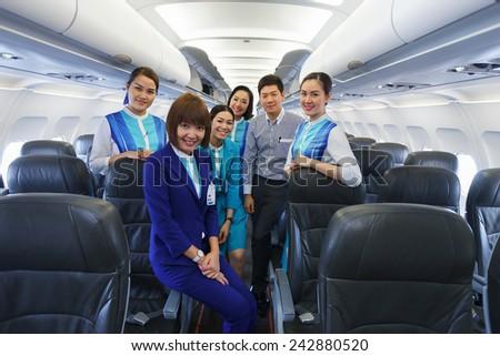PHUKET, THAILAND - NOV 07: Bangkok Airways crew members on November 07, 2014. Bangkok Airways is a regional airline based in Bangkok. Its main base is Suvarnabhumi Airport, Bangkok - stock photo