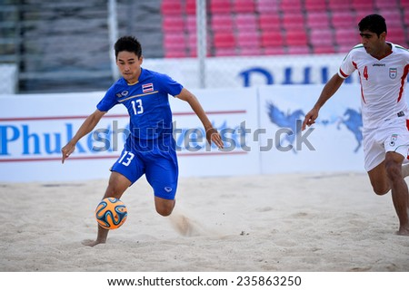 PHUKET THAILAND-NOV19:Vitoon Tapinna(B)of Thailand run with the ball during the Beach Soccer match between Iran and Thailand the 2014 Asian Beach Games at Saphan Hin on November19,2014 in Thailand