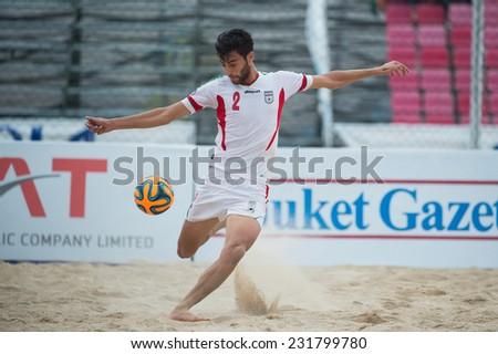 PHUKET THAILAND-NOVEMBER19:Amir Hosein Akbari Fartkhouni of Iran in action during the Beach Soccer between Thailand and Iran the 2014 Asian Beach Games at Saphan Hin on Nov19,2014 in Thailand - stock photo