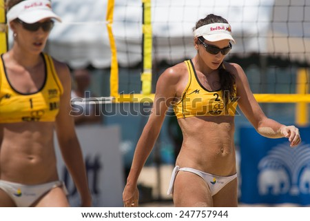 PHUKET, THAILAND-NOVEMBER 1: Carolina Solberg Salgado (R) of Brazil reacts after losing a point during Day 3 match of Phuket Open on November 1, 2013 at Karon Beach in Phuket Thailand - stock photo