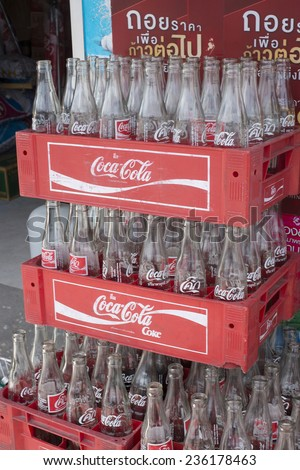 PHUKET,THAILAND - NOVEMBER25, 2014: Empty bottles of Coca Cola in red plastic box. Based on Interbrands best global brand study of 2011, Coca-Cola was the worlds most valuable brand.