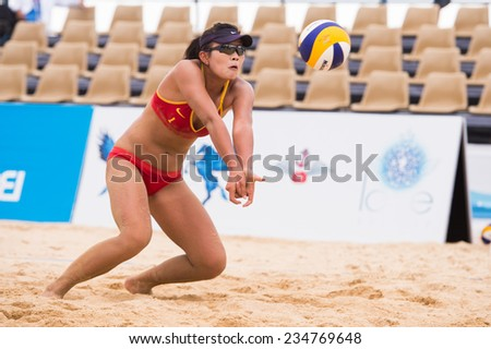 PHUKET THAILAND-NOVEMBER21:Meim ei Lin of China  hits the ball during the Beach Volleyball match between China and Thailand the 2014 Asian Beach Games at Karon beach on Nov 21,2014 in Thailand