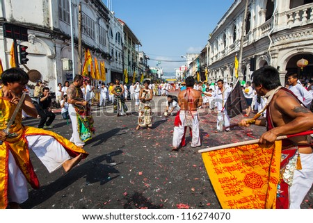 PHUKET, THAILAND - OCT 20: A Taoist devotee participates in the Phuket Vegetarian Festival on Oct 20, 2011 in Phuket, Thailand.  The festival ritual mortification is practiced to appease the Gods.