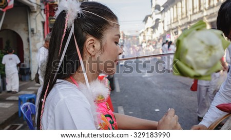 Phuket, THAILAND-OCT 19:A typical scene of Thai Chinese worshipers waiting for the parade of the Phuket Vegetarian Festival in Phuket Town - on October 19, 2015 in Phuket, Thailand
