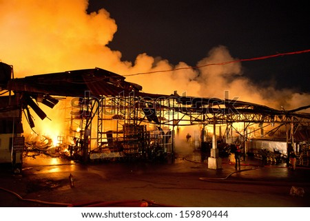 Phuket, THAILAND OCT 16: Fire in Superstore - catch fire in Super Cheap (Big Superstore in Phuket) Substantial damage on October 16, 2013 in Phuket, Thailand