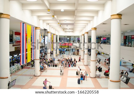 PHUKET, THAILAND- Oct 19: Passengers arrive at check-in counters at Phuket Airport on Oct 19, 2013 in Phuket, Thailand. The airport at density is the second flight of the country. - stock photo