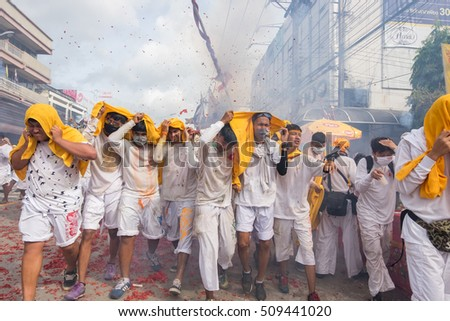 Phuket, Thailand : - October 7, 2016: Devotees of a Chinese Taoist shrine carry a palanquin housing a Chinese God idol in a street procession in Phuket Vegetarian Festival