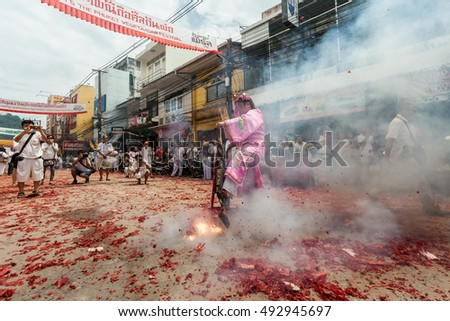 PHUKET,THAILAND - SEPTEBER 30 : Vegetarian Festival SEPTEBER 30, 2014 in Phuket, Thailand. Participants in the festival perform acts of body piercing as a means of shifting evil spirits