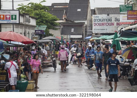 Phuket, Thailand - September 30, 2015: Crowd of people are shopping at fresh-food market in the raining day.