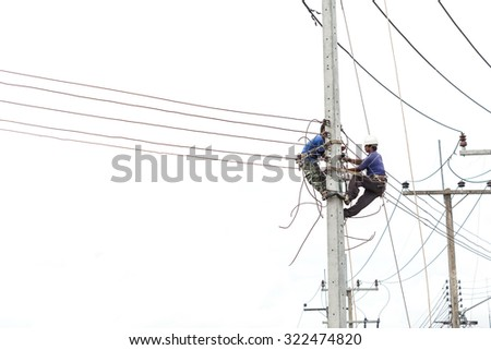 PHUKET, THAILAND - SEPTEMBER 17, 2015: The unidentified people is working on crane for install new traffic light on September 17, 2015 in Phuket, Thailand.