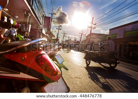 Phuket town street.Road and tuk tuk transport in thailand.Sunset in thailand.Asian travel and adventures - stock photo