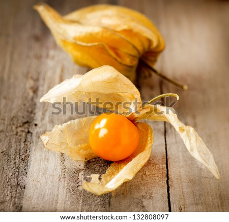 Physalis fruit over Wooden Background