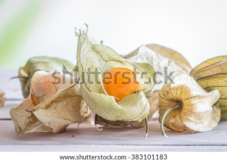 Physalis peruviana fruit on a wooden table
