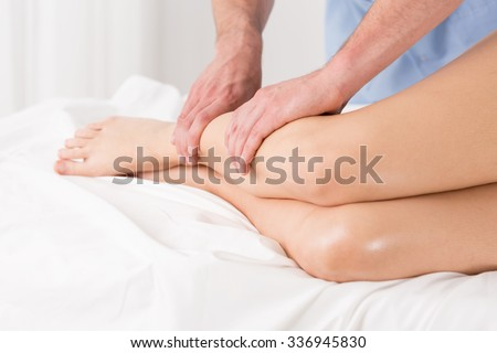 Physical therapist doing lymphatic drainage for the legs - stock photo