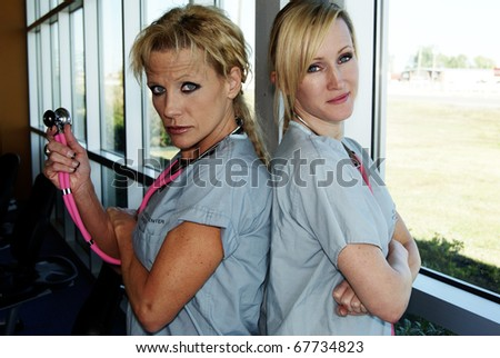 Physical Therapy nurses blond - stock photo